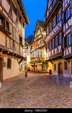 Christmas decorations on typical historic half-timbered,Petite France Strasbourg,wine route, Alsace, Bas Rhin, France - Stock Photo