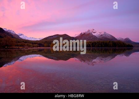 Morning light, Lake Sils, Piz da la Margna behind, Sils, Engadin, Canton of Grisons, Switzerland - Stock Photo