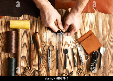 Man working with leather - Stock Photo