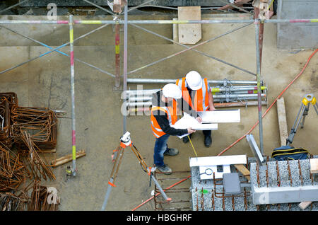 Aerial view of two unrecognized civil engineers inspecting construction site. Building development concept. - Stock Photo