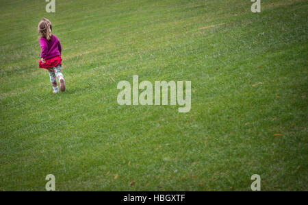 Girl running on the grass - Stock Photo