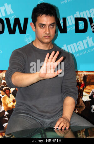 Bollywood actor Aamir Khan gestures during the launch of the DVD of movie Peepli Live in Mumbai, India on November - Stock Photo