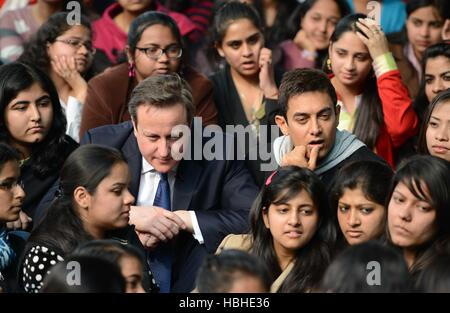 British Prime Minister David Cameron Indian Bollywood actor Aamir Khan interacts students collage Janki Devi Memorial - Stock Photo