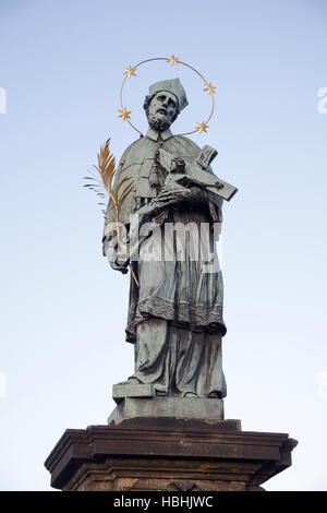 Statue of John of Nepomuk on the Charles Bridge, Prague, Czech Republic - Stock Photo