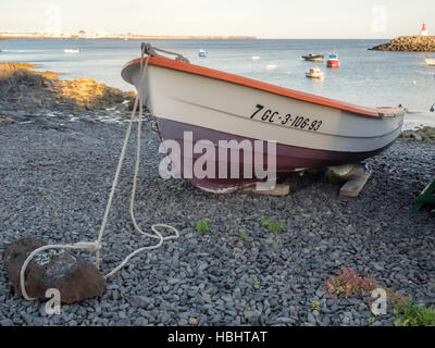 Fisherman boat on a shore - Stock Photo