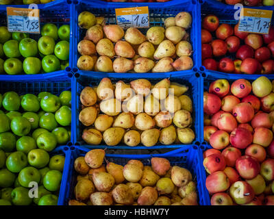 Pears and apples on sale in baskets - Stock Photo