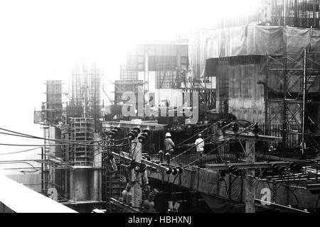 BANGKOK, THAILAND - AUGUST 8: Unidentified laborers at work on August 8, 2011 in Bangkok, Thailand. - Stock Photo