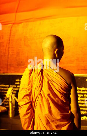 BANGKOK, THAILAND - NOVEMBER 21: A monk directs people during Loy Khratong Festivities at Wat Saket on November - Stock Photo