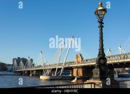 River Thames showing Hungerford Bridge and Charing Cross Station, South Bank, London Borough of Lambeth, Greater - Stock Photo