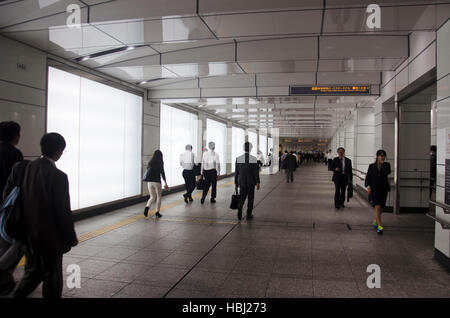 Japanese people walking at shinjuku railway station go to home after finish work at night time on October 19, 2016 - Stock Photo