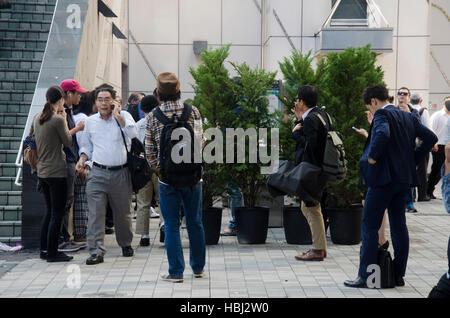 Japanese people smoke cigarette at smoking area in shinjuku city on October 20, 2016 in Tokyo, Japan. - Stock Photo