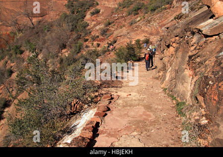 ZION NATIONAL PARK, UT - MARCH 30: Hikers make their way along the popular but strenuous Hidden Canyon Trail. - Stock Photo