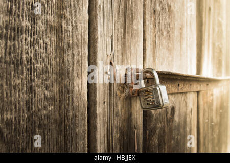 Metal lock on old barn - Stock Photo