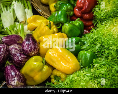 Green, red and yellow peppers on sale - Stock Photo