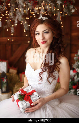 Christmas wedding. Happy bride with gft. Marriage concept - Stock Photo