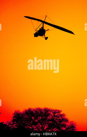 Ultra Light Aircraft on Final Approach - Stock Photo