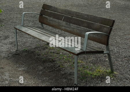 Lonely wooden bench in the park - Stock Photo