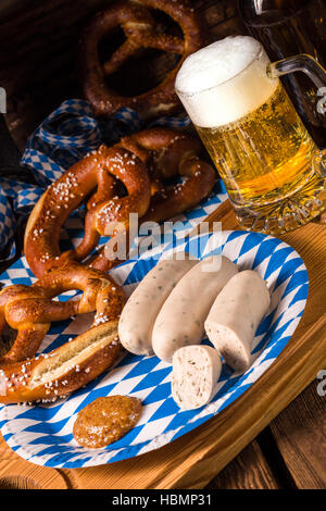 Bavarian sausage with pretzel, sweet mustard and beer - Stock Photo