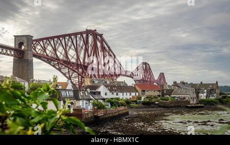 Homes under the Forth Rail Bridge - Stock Photo