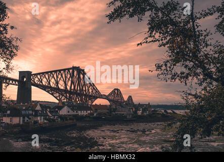 Forth Rail Bridge at dusk in Edinburgh - Stock Photo