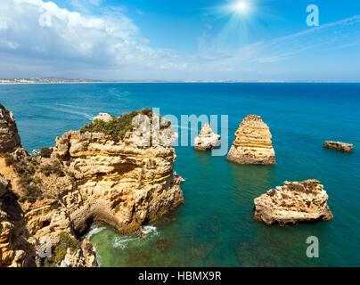 Sunshine above Atlantic rocky coastline (Algarve, Portugal). - Stock Photo