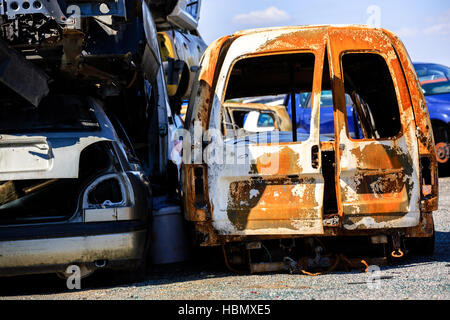 A scrap yard and car dump with wrecked - Stock Photo
