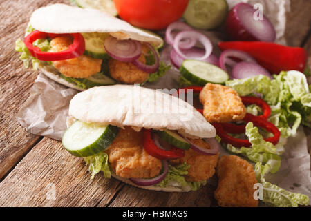 pita with roasted chicken, cucumber, nappa cabbage, onion and bell peppers closeup on the table. horizontal - Stock Photo