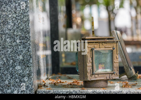 candle lantern on the stone grave - Stock Photo