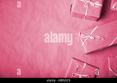Red packed gifts on the table with copy space. Christmas concept. - Stock Photo