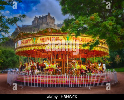 Carousel in front of a castle in Edinburgh - Stock Photo
