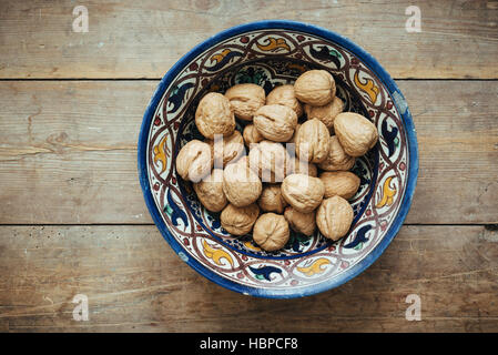 Walnuts in a Moroccan bowl - Stock Photo