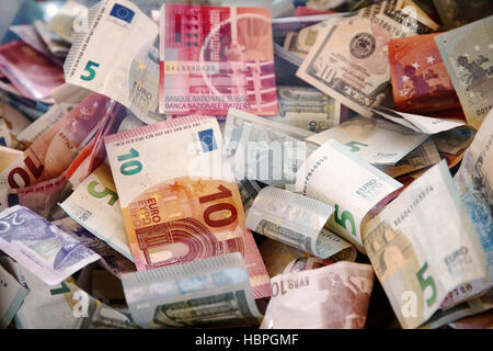 Banknotes of different countries and wrinkled overlapping randomly. Different colors. - Stock Photo