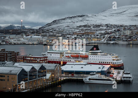 Hurtigruten passenger ship MS Polarlys docked at Hammerfest harbour during a winter voyage to the frozen north of - Stock Photo