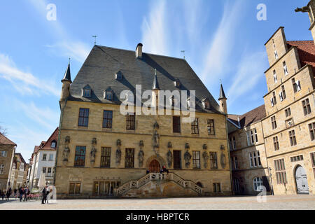 Rathaus building on Markt square in Osnabruck, with people. - Stock Photo