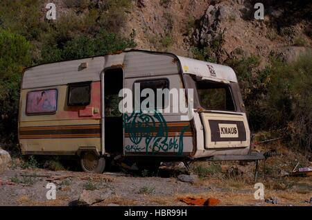 Derelict caravan at Beneficio alternative community, Orgiva, Spain - Stock Photo