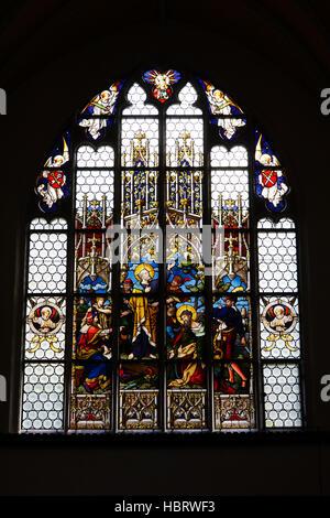 stained-glass window in St. Jodok - Stock Photo
