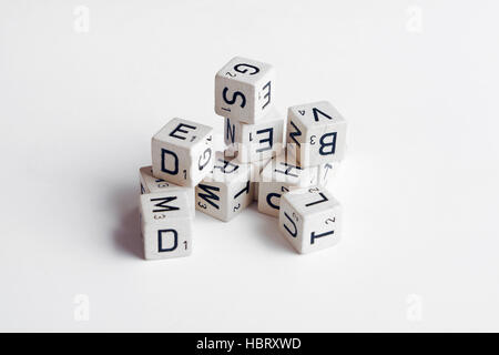 letters and numbers on cubes on white background - Stock Photo