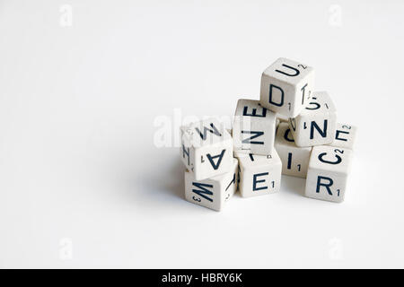 pile of cubes with letters and numbers on white - Stock Photo