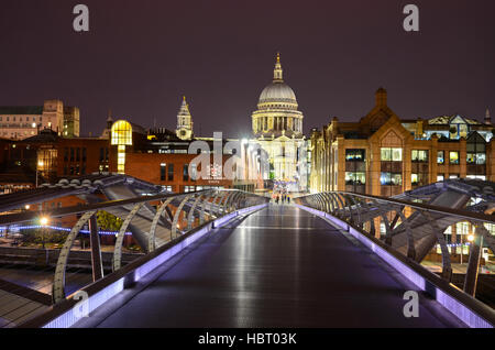 Millennium Bridge, Saint Paul's Cathedral in central London, uk - Stock Photo