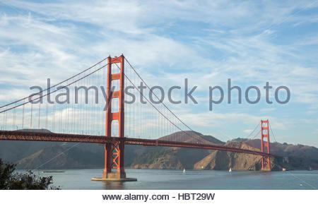 Golden-Gate Bridge in wispy skies - Stock Photo