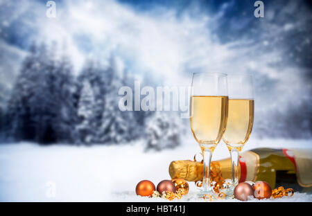 Christmas decorations in front of snow cowered winter background - Stock Photo