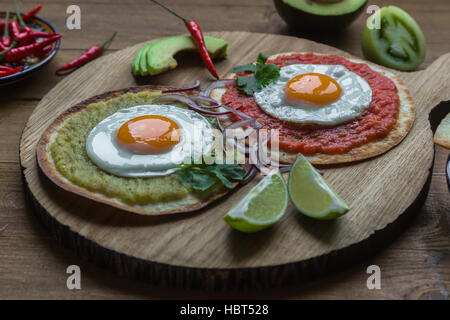 Variety of colorful mexican cuisine breakfast dishes on a wooden table - Stock Photo