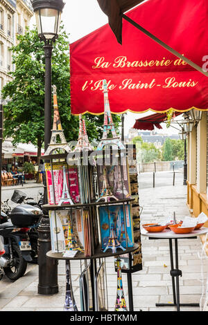 historic paris postcards in a rack in front of a souvenir store - Stock Photo