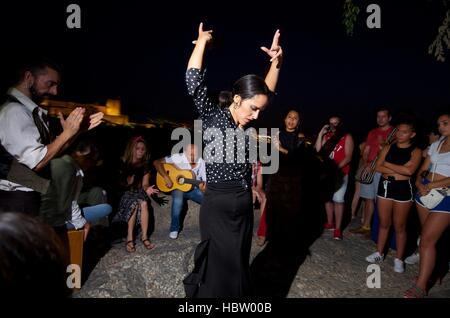 Flamenco dancer Clara Fuentes performing with accompanying musicians in Granada Spain - Stock Photo