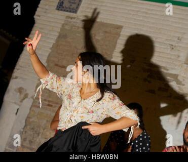 Flamenco dancer Clara Fuentes performing in a Granada street, Spain - Stock Photo