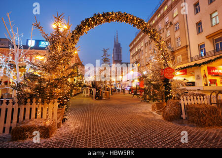 Christmas holidays in illuminated and decorated Zagreb city at Christmas time on Jelacic square. - Stock Photo