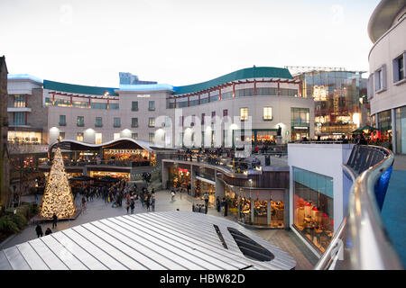 Christmas shoppers in St. Martins Square with Christmas tree taken near Selfridges Department Store, Birmingham, - Stock Photo