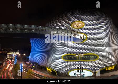 Car light trails outside Selfridges Department Store at night, Birmingham, West Midlands, England, United Kingdom, - Stock Photo