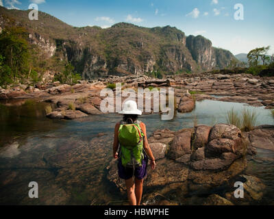 Girl on a hike trough the rivers and the mountains of Chapada dos Veadeiros - Stock Photo