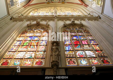 Stained-glass windows  in medieval Sint-Janskathedraal (St. John's Cathedral) in the city of Den Bosch, Brabant, - Stock Photo